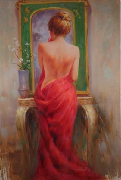 Junge Frau am Spiegel