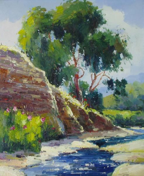 Bäume und Felsen am Bach